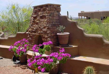 An outdoor fireplace feature provides height and a little privacy to this backyard.