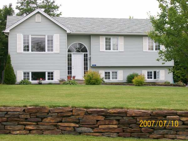 This 160 ft. ironstone wall, snakes through the whole front yard of this large property.