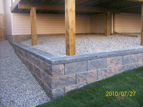 This small wall was added to eliminate having a slope that would be difficult to mow.
