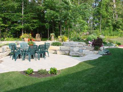 A patio surround made with large placement stones.