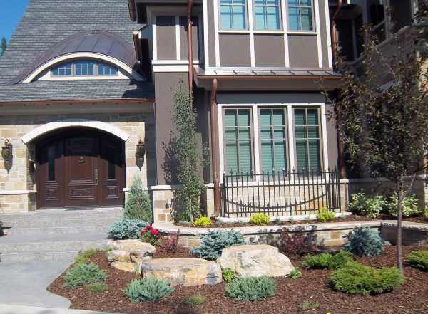 Small front yard design mixing formal and informal elements.
