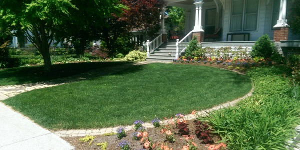 Brick edging was used as a way to provide easy mowing and a clean defined border for this front yard.