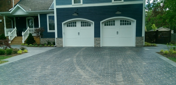A nice brick Paver stone driveway that compliments the colours of the home. Formal square pavers also line each side of the driveway and lead to the front and back yards.