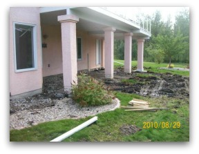 Before shot of a lawn that will need to be blended with new sod, soil, and the old lawn.