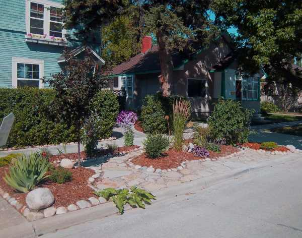 This designated heritage property in the middle of a city has a front yard full of character.