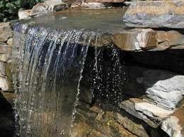 Waterfall running over stones.